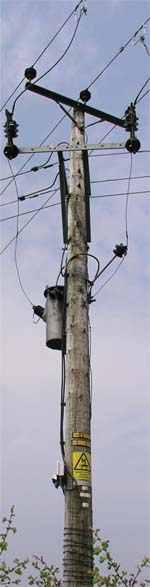 A powerful looking electricity distribution pole